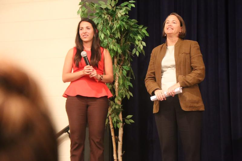 TIRRC's Camila Fyler helps Attorney Bethany Jackson with Justice For Our Neighbors take audience questions in spanish at Glencliff High School on Thursay evening.