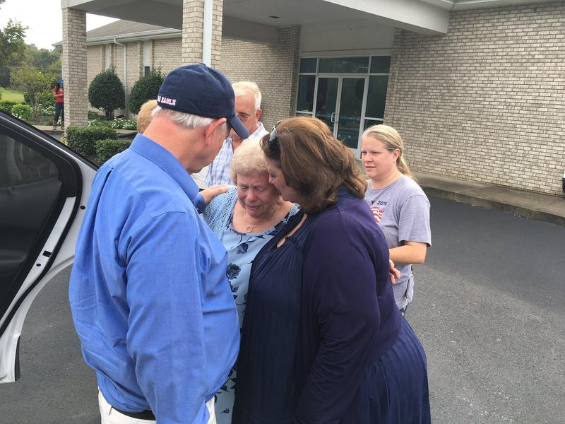 Mary Pitts, middle, locked herself in the bathroom after she heard gunshots at Burnette Chapel.