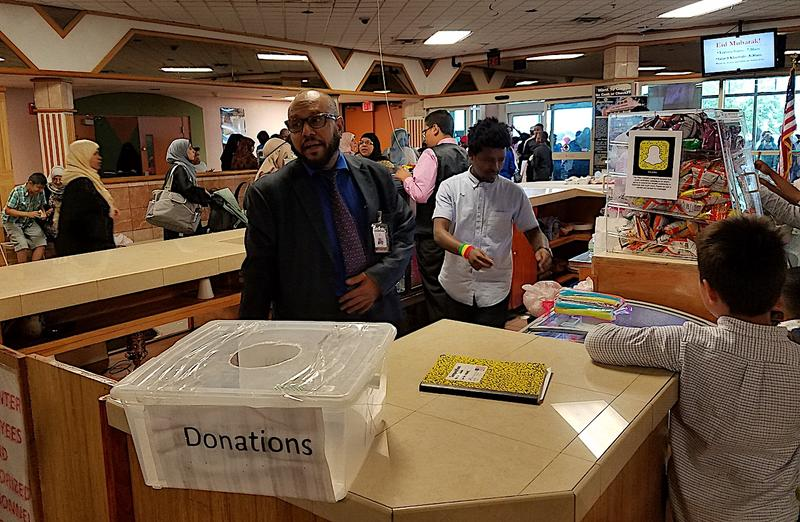 Ali Nooraddiin, executive director of the Islamic Center of Tennessee, stands behind the snack bar of the one-time movie theater during one of its busiest holidays of the year.