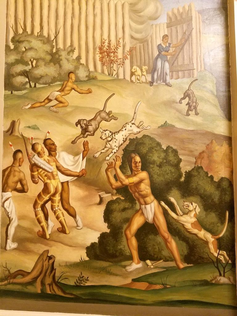 "A panel shows the so-called ""Battle of the Bluff"" — a confrontation at Fort Nashborough between Native Americans and white settlers."