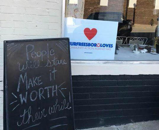 "A local business displays a ""Murfreesboro Loves"" sign in defience of Saturday's rally. Most privately owned estblishments plan to close."