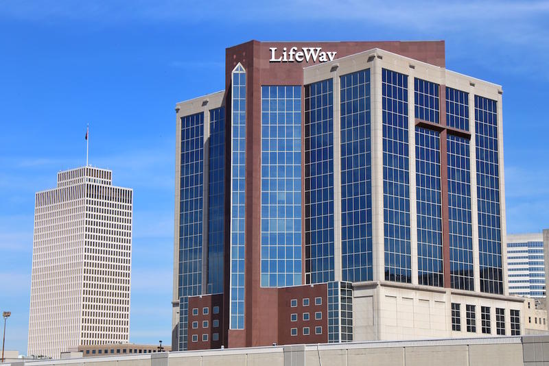 Two sides of LifeWay's Draper Tower have stone crosses that were glued to the steel structure.