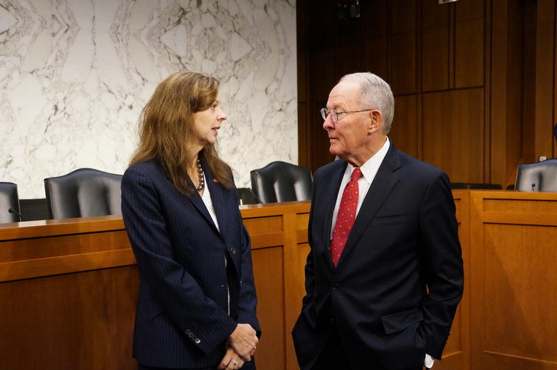 Tennessee Insurance Commissioner Julie Mix McPeak talks to Sen. Lamar Alexander before testifying before the health committee, which he chairs.