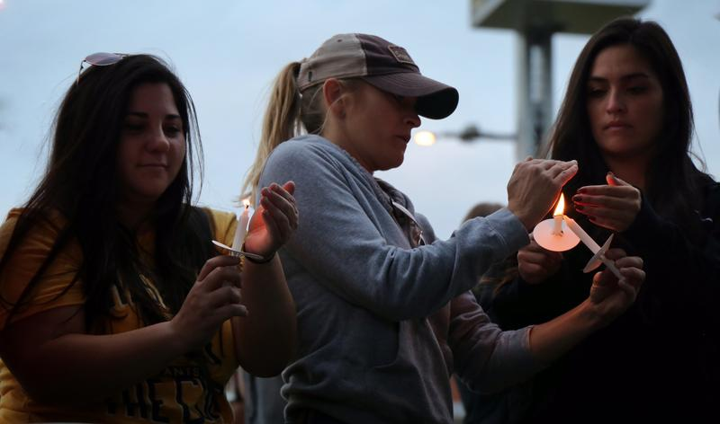 Mourners in Nashville light candles in honor of the victims of the mass shooting at a country music festival in Las Vegas.