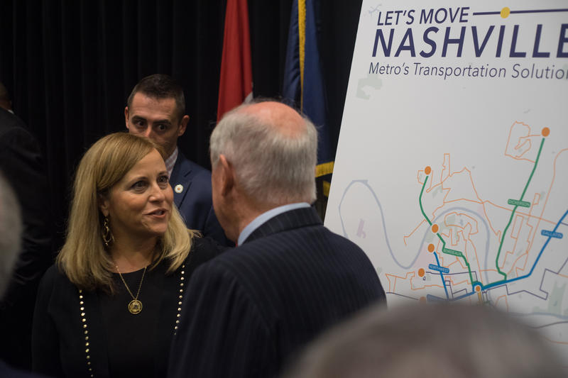 Nashville Mayor Megan Barry speaks with Phil Bredesen, a former mayor. In all, four mayors of Nashville attended Tuesday's announcement to show their support.