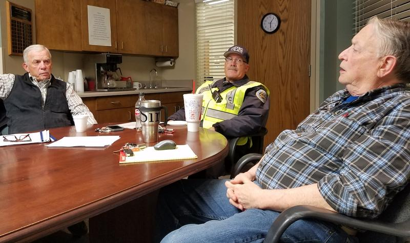 As an off-duty Metro police officer listens, Brentwood Hills Church of Christ members Dick Garner and Don Barker discuss presenting their recent assessment of potential risks to the church, including the possibility of an attempted shooting.