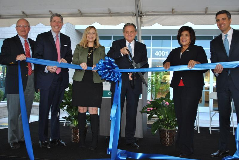 CHS CEO Wayne Smith cuts the ribbon on the company's new office in Antioch alongside Nashville Mayor Megan Barry.