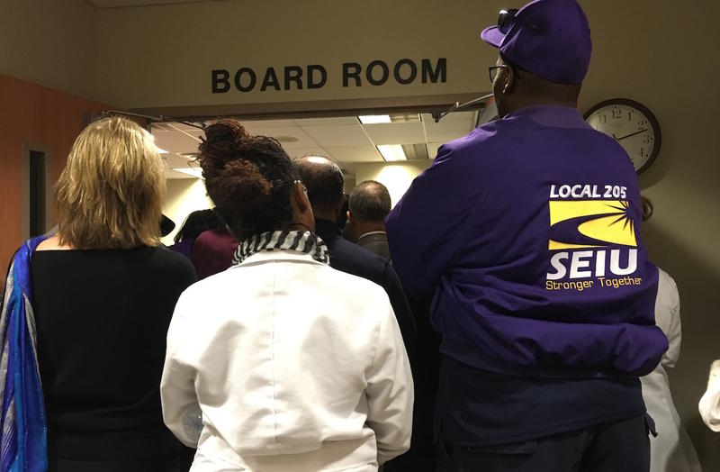Nashville General Hospital staffers stand outside an emergency board meeting this month as the hospital is slated for a massive restructuring. The hospital has more than 500 employees, according to the most recent figures.