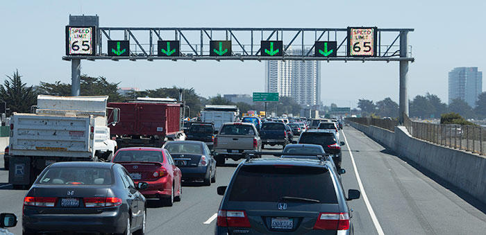 """Overhead signage alerts drivers to lane closures and changes in the speed limit on a """"smart corridor"""" near Oakland, Calif."""