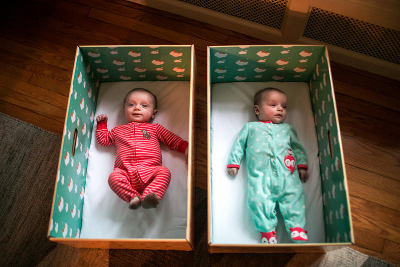 Twins Ryan and Nell Stimpert lie in their baby boxes at home in Cleveland, Ohio. The cardboard boxes are safe and portable places for the babies to sleep.