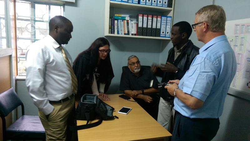 Professors get a demonstration of mUzima from the project's team in Kenya.