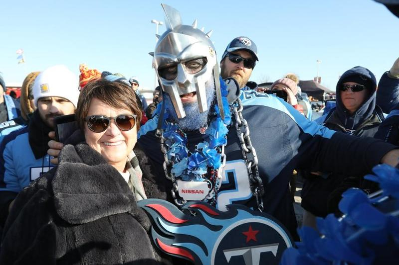 Titans controlling owner Amy Adams Strunk with fan in Kansas City