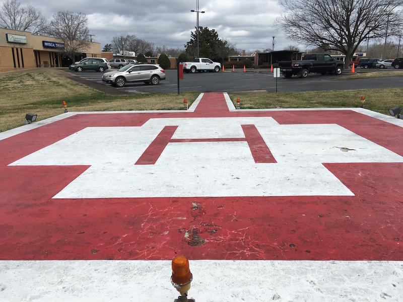 The Lewis Health Center, which was previously a hospital, still has a helipad outside for transporting patients.