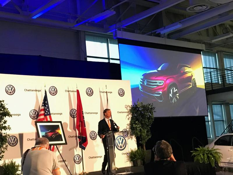 Tennessee Governor Bill Haslam stands beside a concept drawing of the new VW Atlas five-seater at the carmaker's Chattanooga assembly plant.