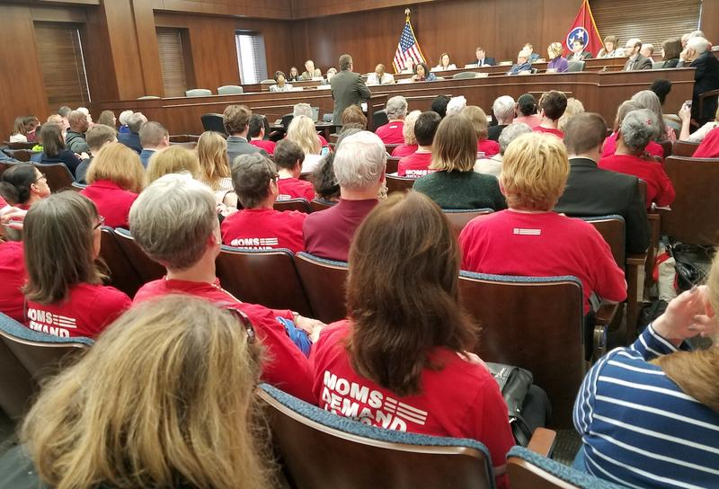 Members of the advocacy group Moms Demand Action for Gun Sense in America listen as legislators debate a measure that would've allowed teachers to carry handguns.