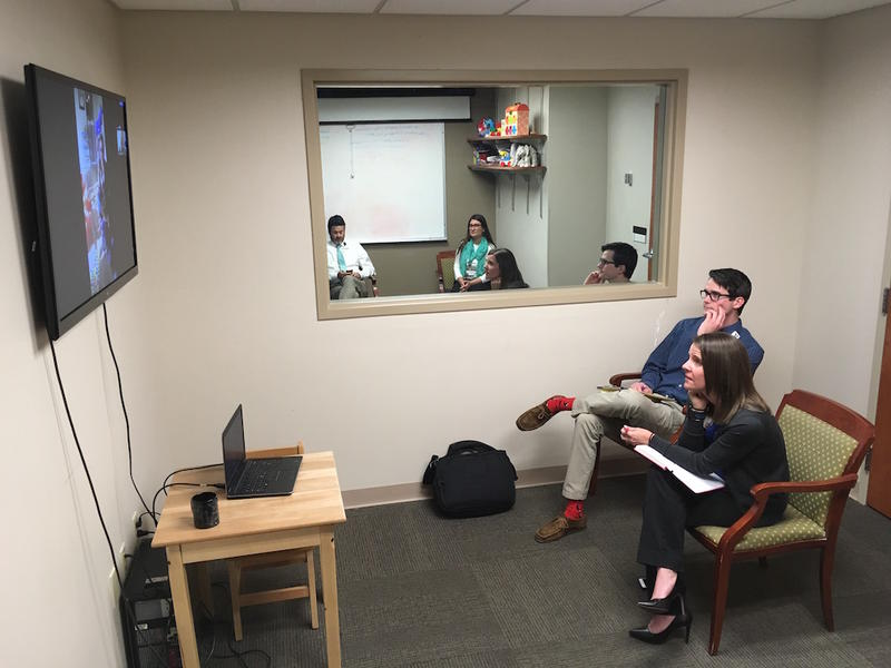 Behavioral analyst Will Martin and early intervention coordinator Alacia Stainbrook at Vanderbilt's autism spectrum disorder clinic conduct a video conference session with Stacey Copeland and her son, River.