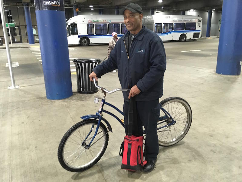 Ken Askew, 64, rides an MTA bus from his home near Tennessee State University to his downtown office building each day. He brings along his bike for midday trips.