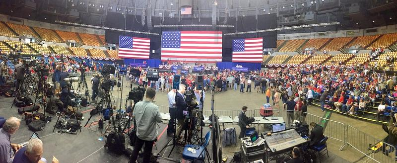 Supporters of President Trump and some reporters get situated in Municipal Auditorium about three hours before the rally is scheduled to start.