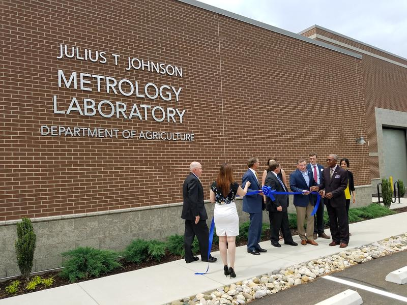 Former Agriculture Commissioner Julius Johnson, left; Gov. Bill Haslam, center; and other state officials gathered outside the state's new metrology lab for a ribbon-cutting ceremony.