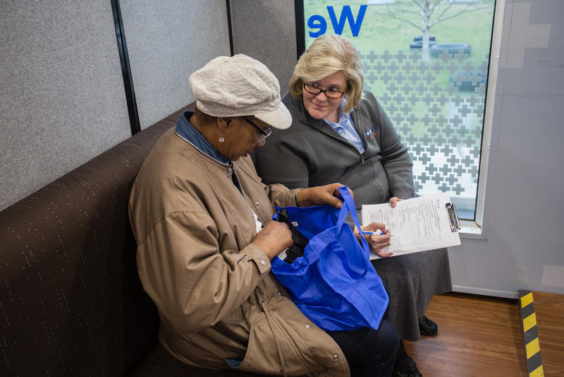Insurance advisor Kimberly Clayton works with an enrollee at a BlueCross BlueShield of Tennessee mobile information center.