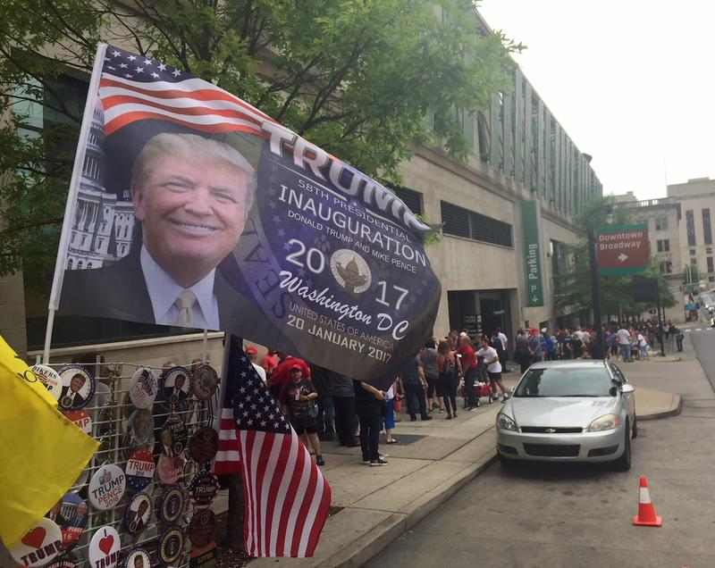 Supporters of President Donald Trump line up outside Municipal Auditorium hours before a rally.