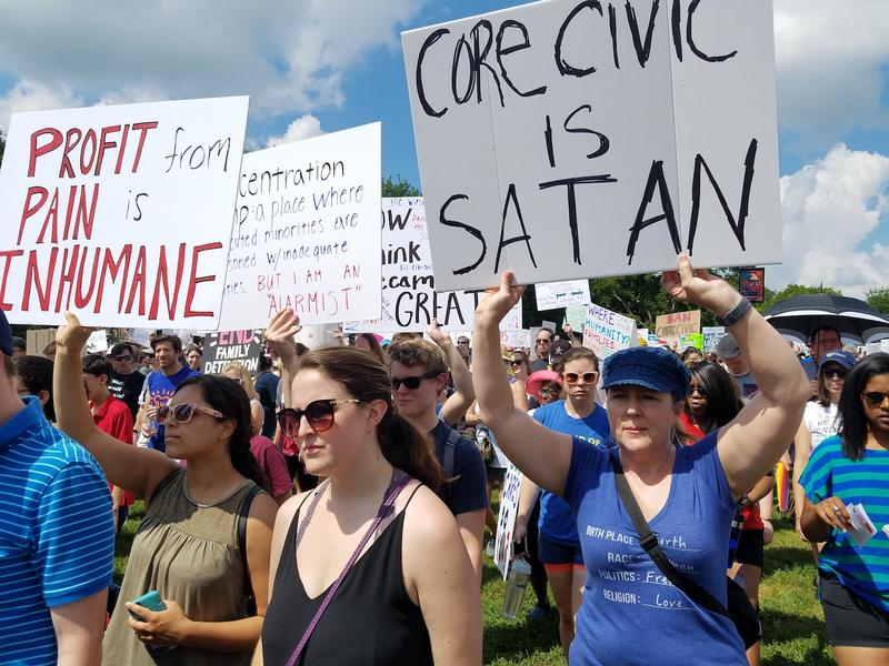 Opponents of President Trump's immigration policies marched in Nashville on Saturday, in part to protest CoreCivic's operation of an immigration detention center. The company says it has no role in developing immigration policy and acts humanely.