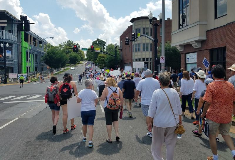 Protesters marched along Blakemore Avenue from Fannie Mae Dees Park to an intersection across from Belmont University.