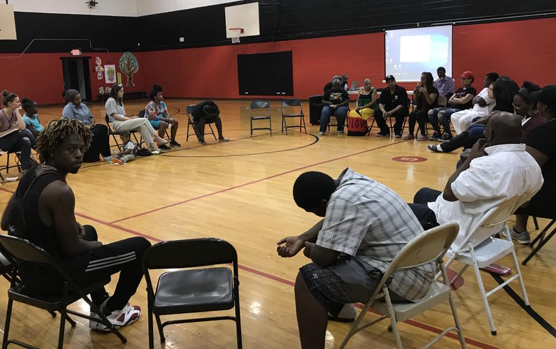 The Chicago-based anti-violence orgnaization Cure Violence spoke at the Napier Community Center last week about treating gun violence as a public health epidemic.