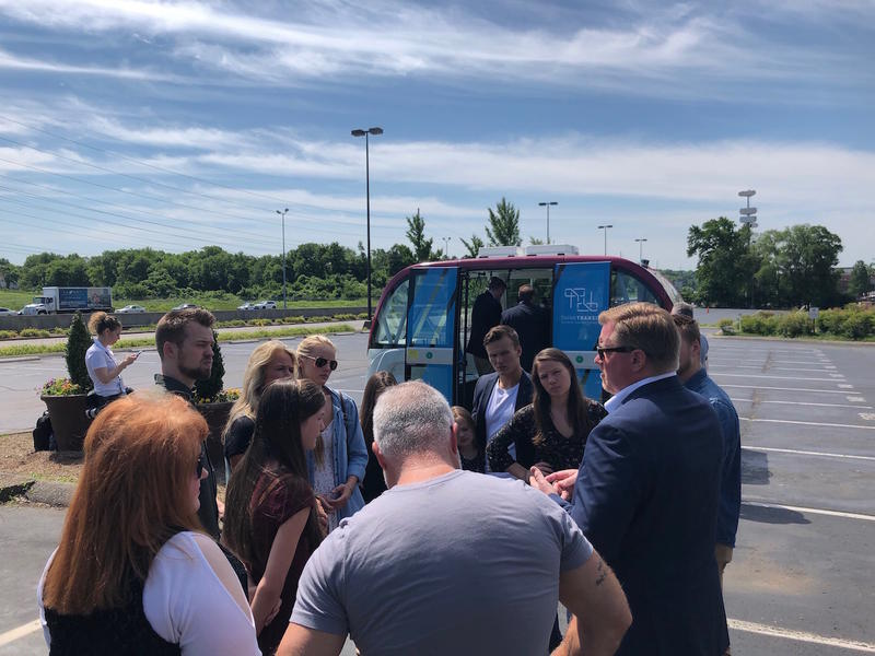 Attendees get ready to go for a ride with the NAVYA Autonomous Shuttle.