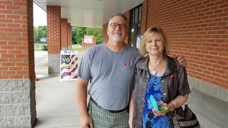 Bryan and Susan Brand, a retired hospital administrator and a retired oncology nurse, cast their ballots this afternoon at Franklin Elementary School.