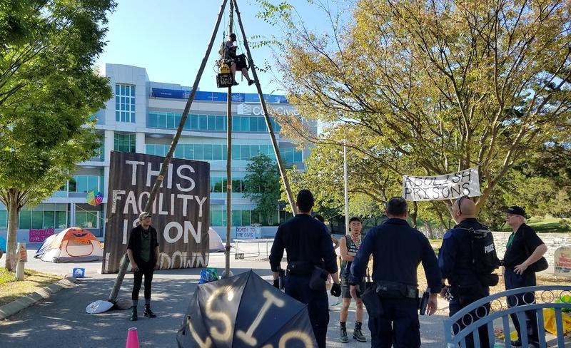 Demonstrators blockaded the entrances to CoreCivic's headquarters in Nashville Monday for about eight hours.