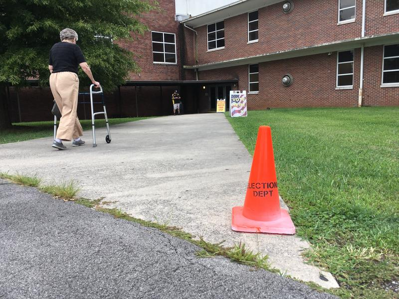 A woman heads in to vote at Central Magnet High School in Murfreesboro.