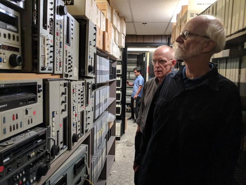 Skip Pfeiffer, right, and Russ Mason look at the now-unused playback machines and recording devices in the basement of the archive.