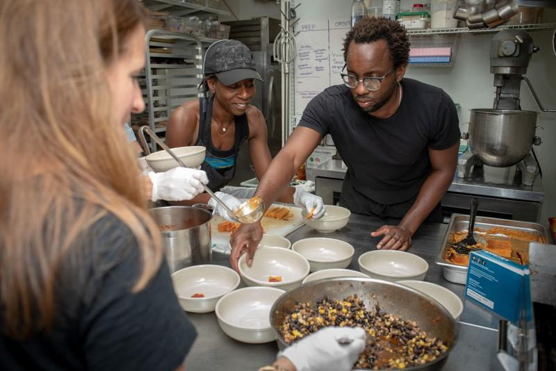 Chef Tunde Wey prepares a meal as part of the Metro Arts Commission's Build Better Tables program. He hosts a series of dinners this week dealing with gentrification.