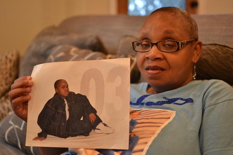 Vickie Hambrick holds a photo of her son, Daniel Hambrick.