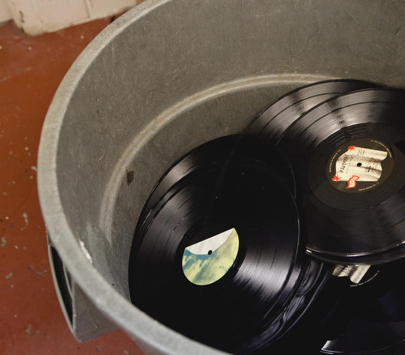Rubbish. Labels get punched out and vinyl gets recycled.