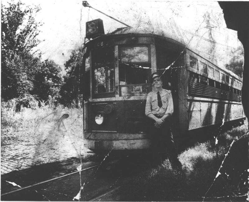 Conductor Robert O. Ray standing at the end of the Glendale Park streetcar line around 1938.