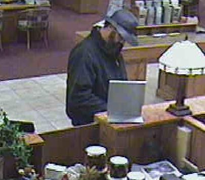 The gunman who robbed the First Interstate Bank in Laramie Wednesday wore a hat and beard and avoided looking at security cameras.