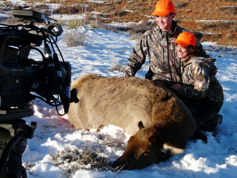 "Kyle Thomas, 14, and his mom, Mary Billier, pose with an elk Kyle killed at Wagonhound Ranch near Douglas. A TV crew recorded his experience for an upcoming reality show called ""Call of the Wild"" intended to entice young people to take up hunting."