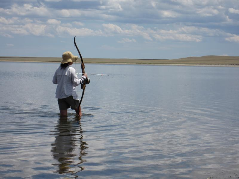 "Janet ""Ogre"" Chen stalks common carp with a bow and arrow in Wheatland Reservoir #3."