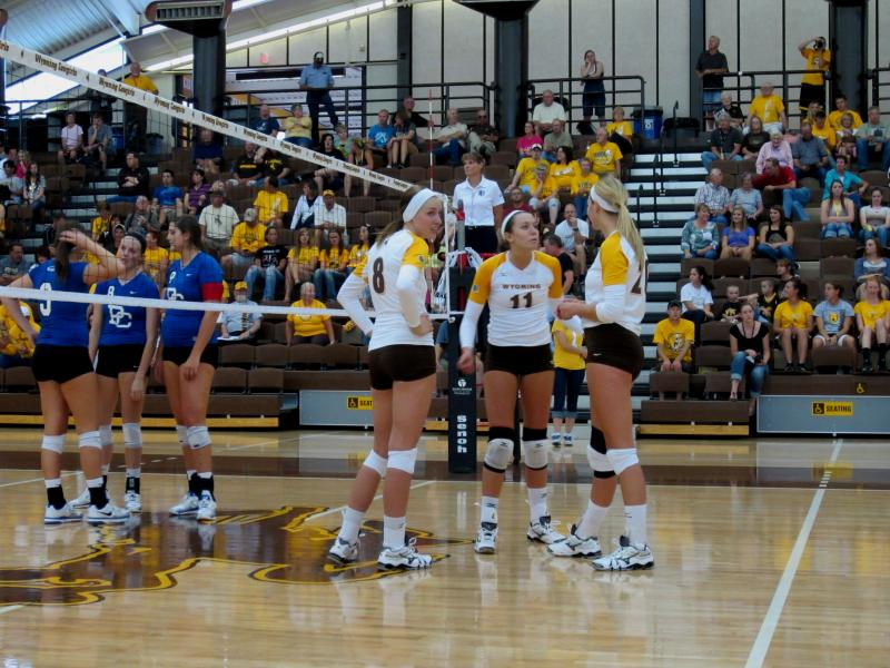 UW Cowgirls pause during a match