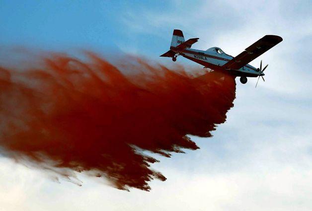 A plane drops fire retardant on the wildfire at Casper Mountain.