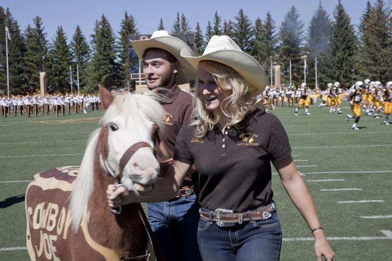 Cowboy Joe IV makes his way off the field with his handlers during University of Wyoming's first home football game of the 2012 season. He's retiring this season, and will be replaced by Cowboy Joe V.