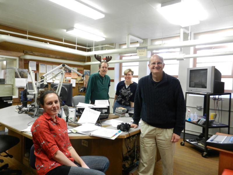 Wyoming Public Radio studio celebrating Year-End Drive - Irina Zhorov, Grady Kirkpatrick, Shaun Wilhelm, Bob Beck
