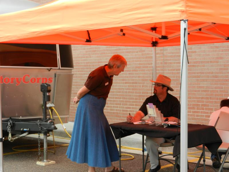 CJ Box talking with a Laramie County Librarian, Lucie Osborn