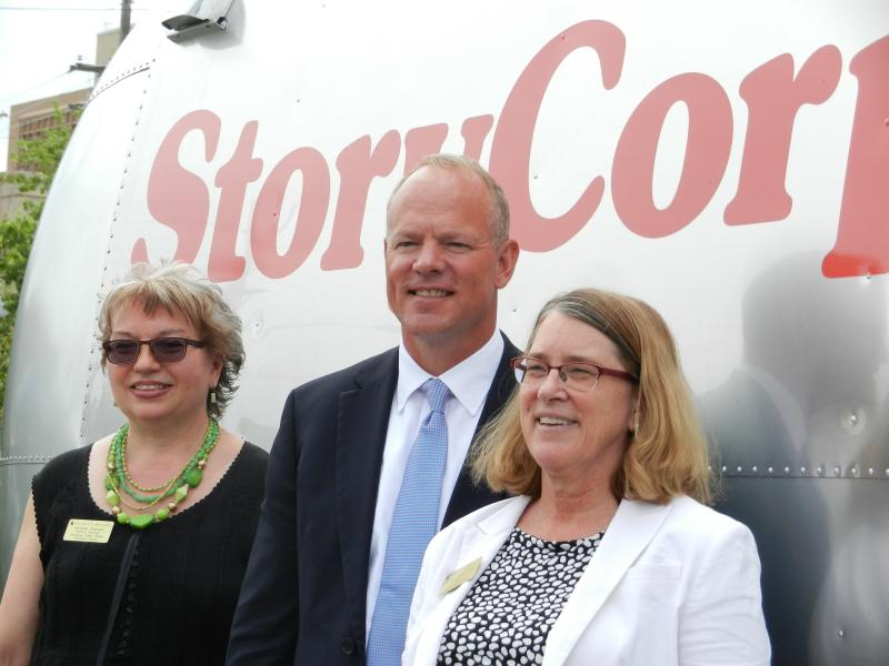 WPM General Manager Christina Kuzmych, Governor Matt Mead, and Incoming Dean, UW Outreach School, Dr. Susan Frye pose by the StoryCorps Mobile Trailer