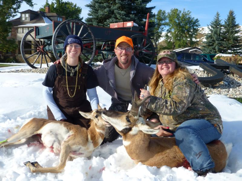 Left to right, Tara Heaton, guide Fred Williams, and Crystal Mayfield pose with their antelope on the second day of the hunt.
