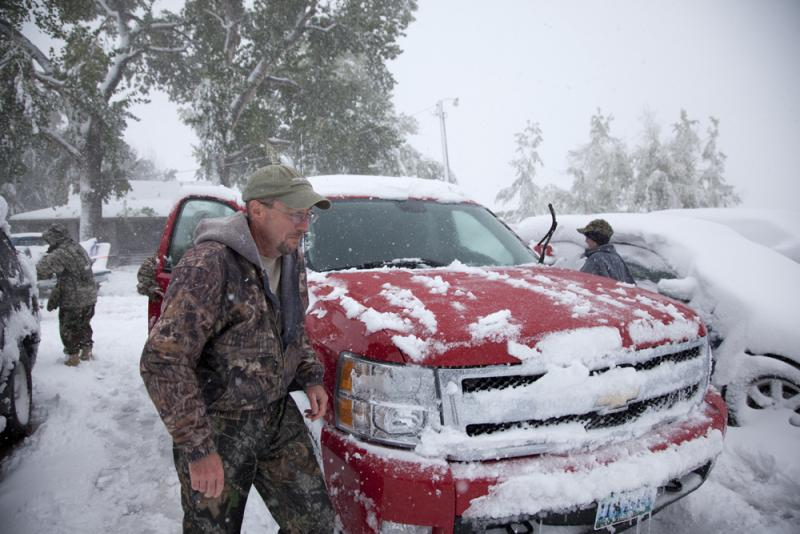 Guide Fred Williams cleans off his truck and prepares to set out on the hunt.