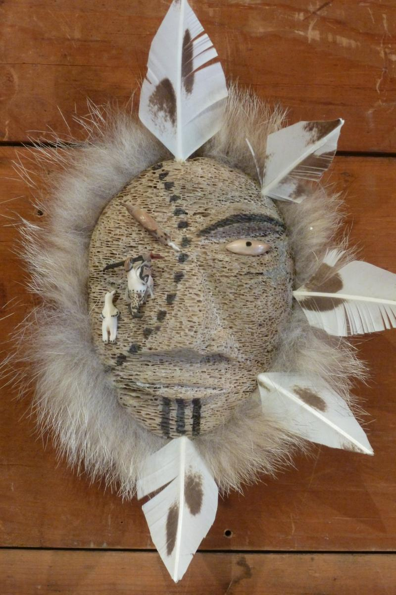 Inuit mask from Alaska made from whale bone, seal fur and feathers
