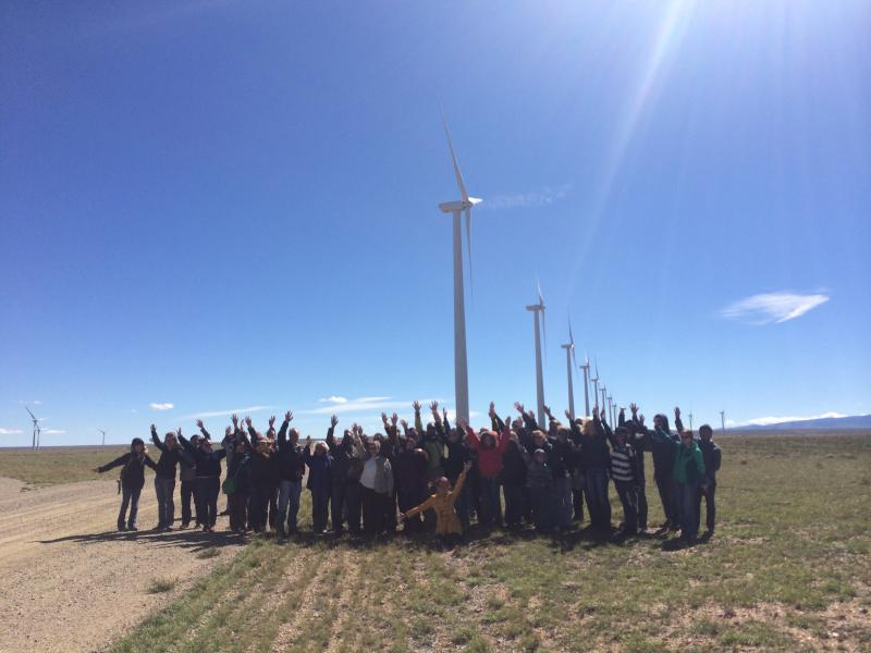 Tour group gathers in front of the High Plains Wind Farm